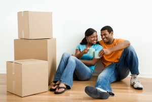 Portrait of couple with boxes.