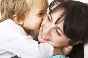 little boy hugging her mother